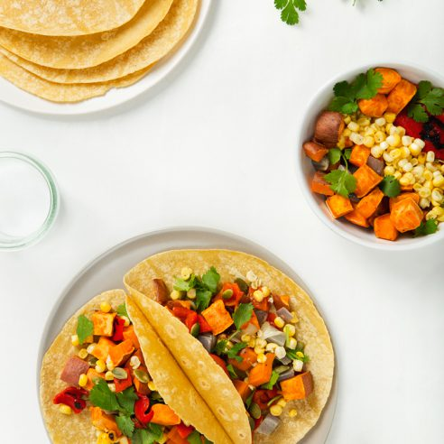 Sweet Potato Tacos with Grilled Corn & Roasted Red Pepper | picklesnhoney.com #vegan #glutenfree #recipe #tacos #cincodemayo