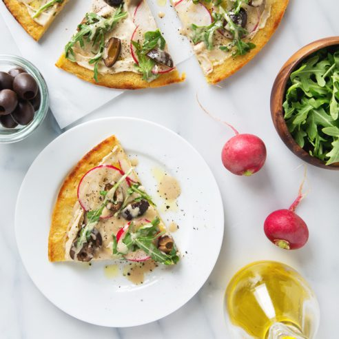 Simple Spring Socca Pizza (Vegan & GF) Only 8 ingredients + 25 minutes to make! | picklesnhoney.com #socca #pizza #vegan #glutenfree #recipe