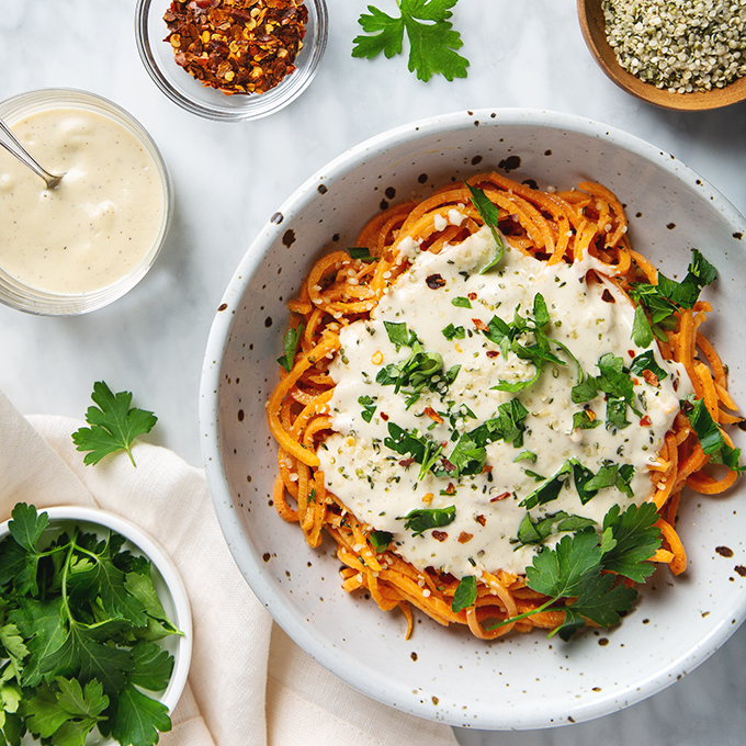 Healthy Sweet Potato Noodles with 5-Minute Vegan Alfredo Sauce! You're going to want to put this sauce on everything! | picklesnhoney.com #sweetpotato #noodles #vegan #alfredo #sauce #recipe #glutenfree #noodles #lunch #dinner