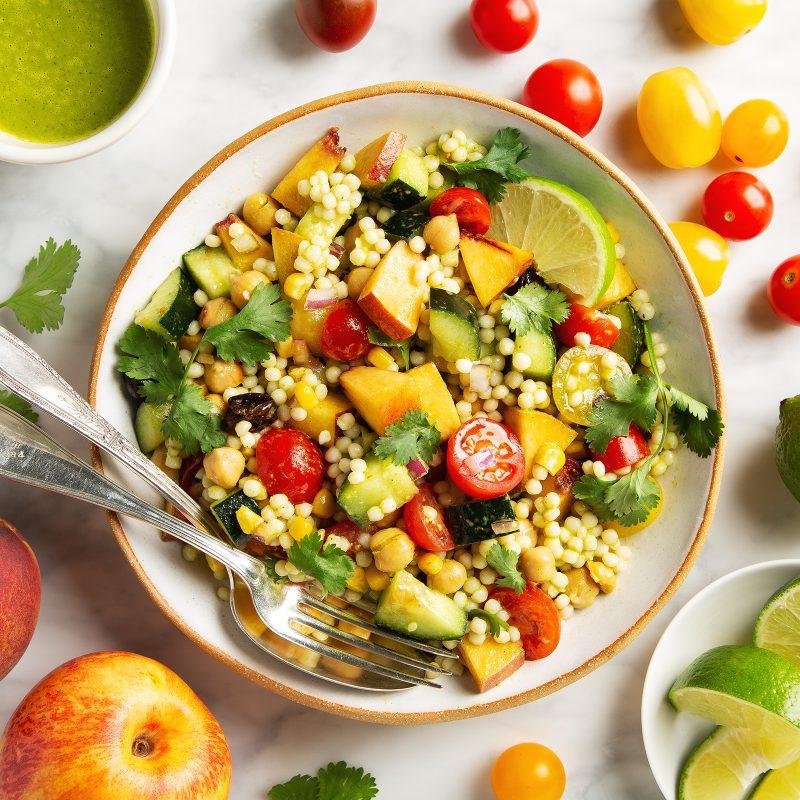 Summer Couscous Salad with Cilantro Lime Vinaigrette | picklesnhoney.com #summer #couscous #salad #cilantro #lime #vinaigrette #side #lunch #dinner #vegan #recipe